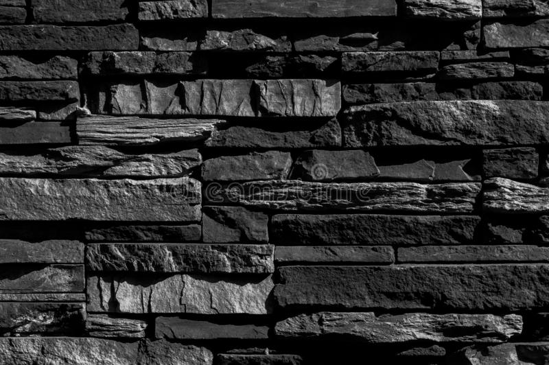 Natural black charcoal for background. Industrial coal mineral stone. Dark grey black slate abstract background or stock photos