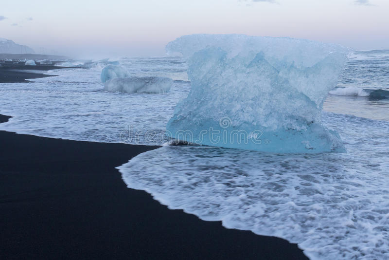 Natural black sand beach with Ice breaking on top. Iceland natural winter season landscape background stock images