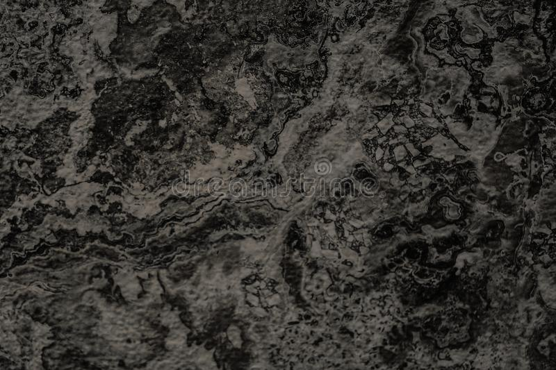 Natural black stone wall background or texture background for in royalty free stock photos