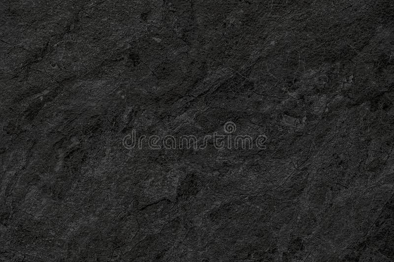 Natural black stone wall background or texture background for in stock photos