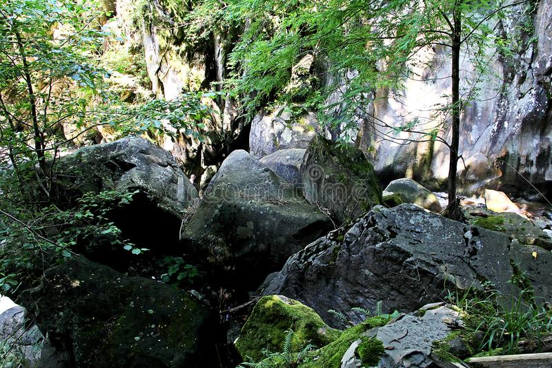 Natural blockage by the boulders. Natural blockage by the boulders to the gorge of mountain river stock images