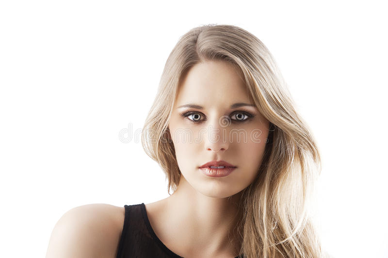 Natural blond woman, she is in front of the camera royalty free stock images