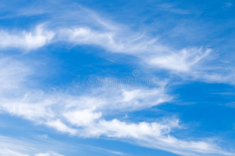 Natural blue cloudy sky at daytime. Background photo texture royalty free stock photo
