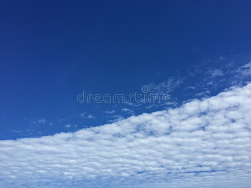 Natural blue sky with soft small puffy clouds stock images