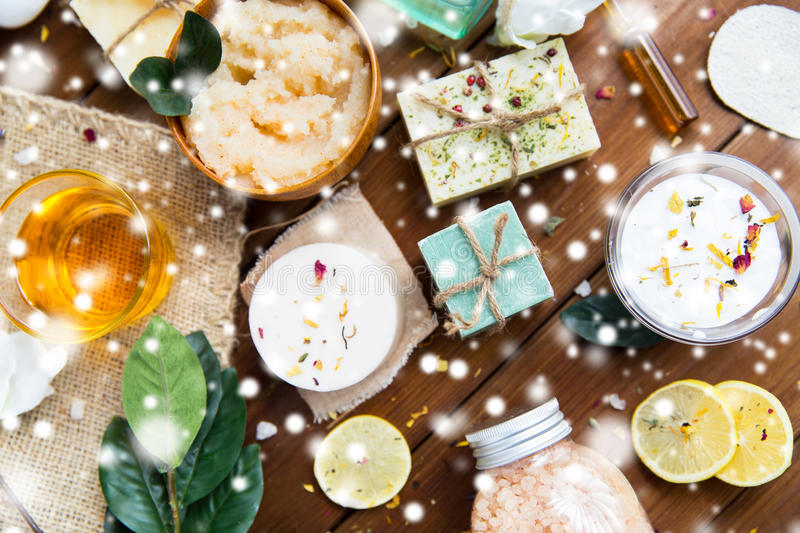 Natural body care cosmetics on wood. Beauty, spa, therapy, bodycare and wellness concept - natural body care cosmetics on wood over snow royalty free stock photography