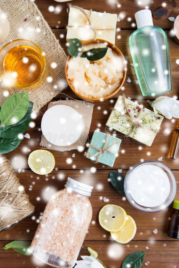 Natural body care cosmetics on wood. Beauty, spa, therapy and wellness concept - natural body care cosmetics on wood over snow stock images