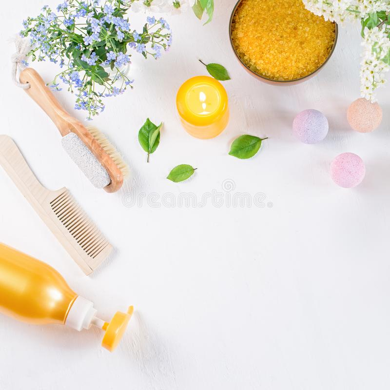 Natural body care products and accessories lay out with flowers and leaves. Eco friendly spa, beauty cosmetics concept. With copy space royalty free stock image