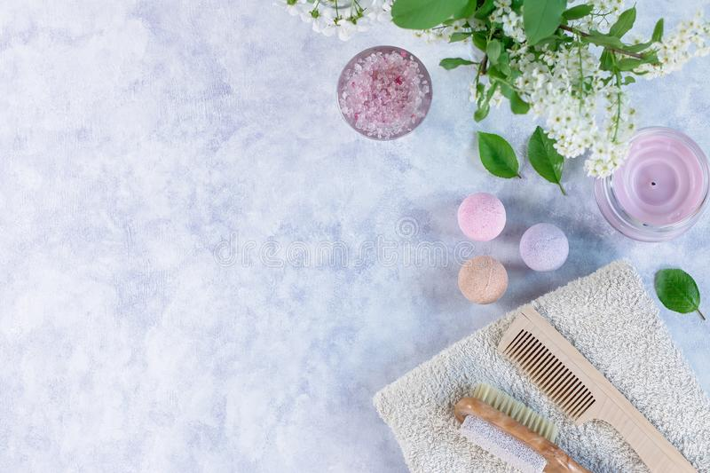 Natural body care products and accessories lay out with flowers and leaves. Eco friendly spa, beauty cosmetics concept. With copy space stock images