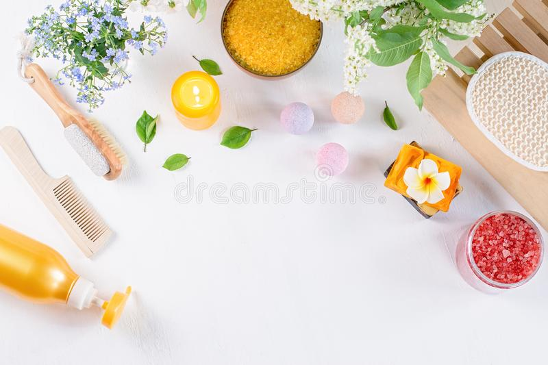 Natural body care products and accessories lay out with flowers and leaves. Eco friendly spa, beauty cosmetics concept. With copy space stock photos