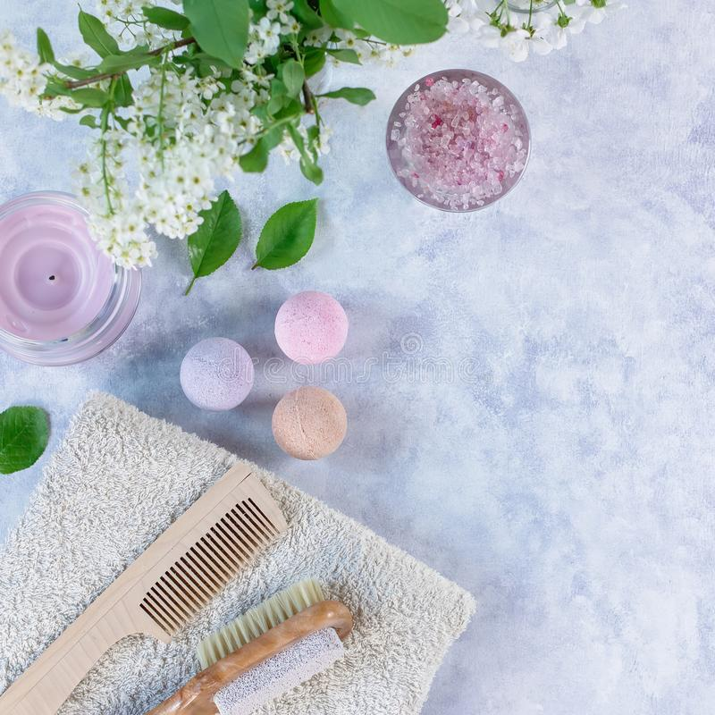 Natural body care products and accessories lay out with flowers and leaves. Eco friendly spa, beauty cosmetics concept. With copy space stock image