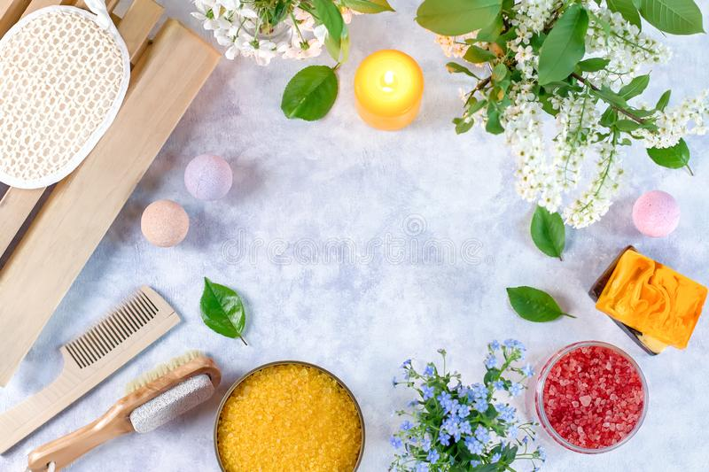 Natural body care products and accessories lay out with flowers and leaves. Eco friendly spa, beauty cosmetics concept. With copy space stock photography