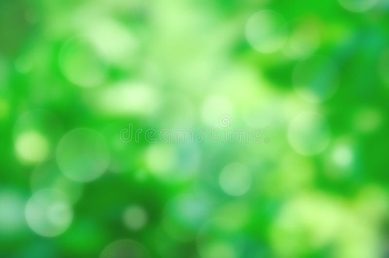 Natural bokeh. Natural outdoors bokeh in green and yellow tones stock photo