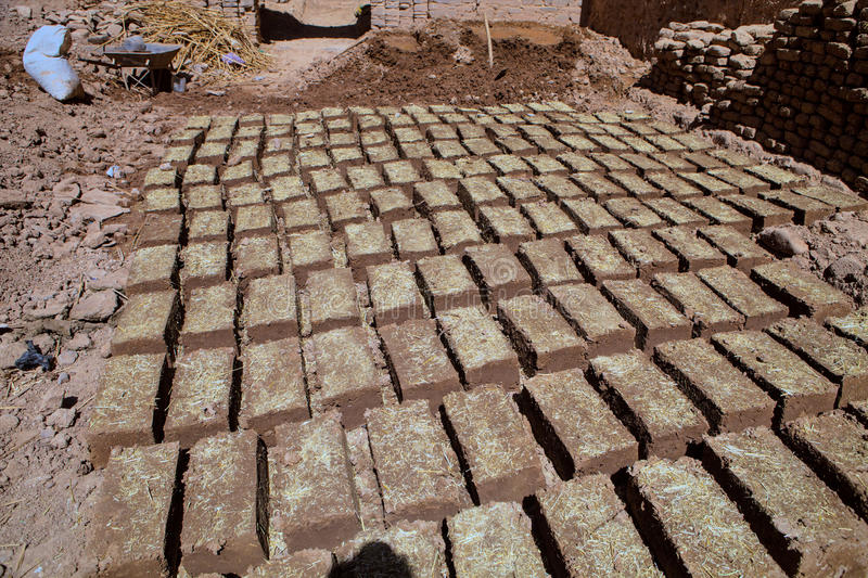 Natural bricks drying in the sun, Morocco. Many Natural bricks drying in the sun, Morocco royalty free stock photography