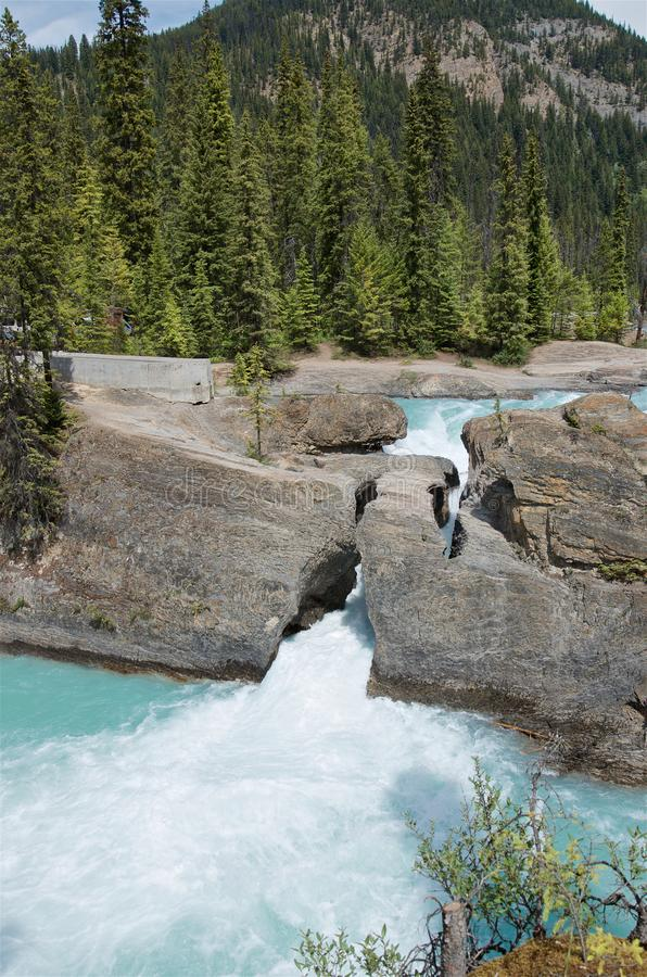 Natural bridge over the Kicking Horse River it`s a stone carved by water in Yoho National Park stock photos