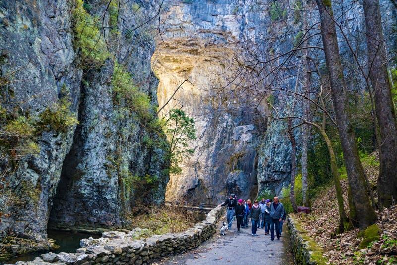 Visitors at Natural Bridge State Park, Virginia, USA. Natural Bridge State Park, Rockbridge County, VA, January 1st: A large group of visitors walking under stock images