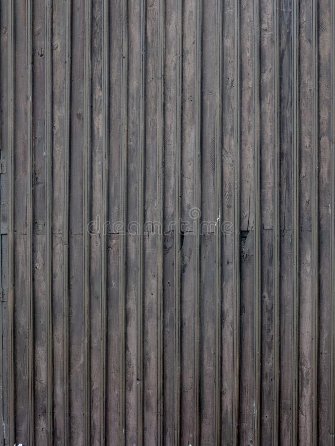 Natural brown barn wood wall. With dark brown planks royalty free stock photos