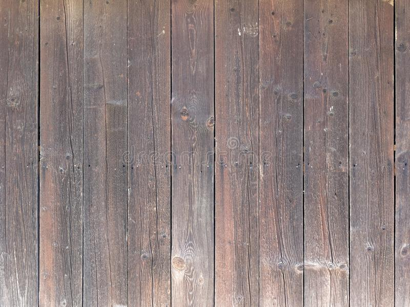 Natural brown barn wood wall. With vertical planks royalty free stock images