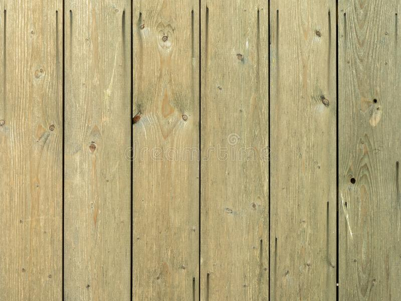 Natural brown barn wood wall. With vertical planks and visible nail heads stock photo