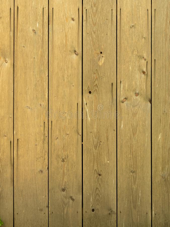 Natural brown barn wood wall. Vertical planks royalty free stock images