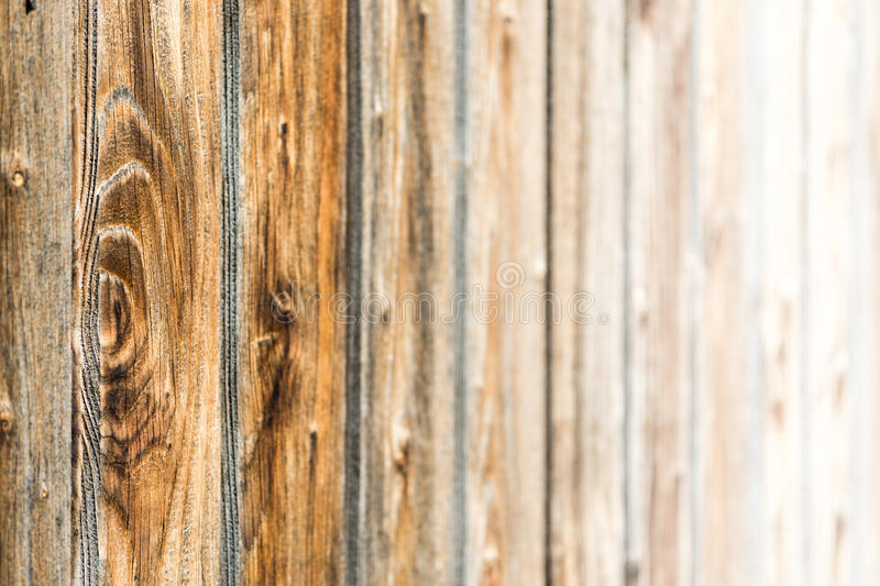 Natural brown barn wood wall. Wooden textured background pattern. Natural brown barn wood wall. Wooden wall background design. Wood planks, boards are old with royalty free stock image