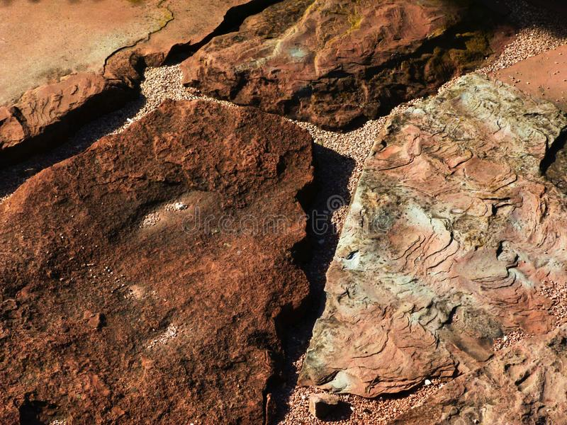 Red sand stone paving with rustic rough layered split surface and strong grit texture. Natural brown quartz or sand stone type of paving with rustic rough stock photography