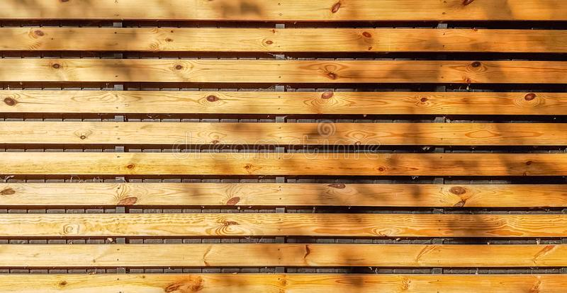 Natural brown wood plank lines arrange pattern texture background. Seamless wooden structure of floor or sidewalk royalty free stock photos
