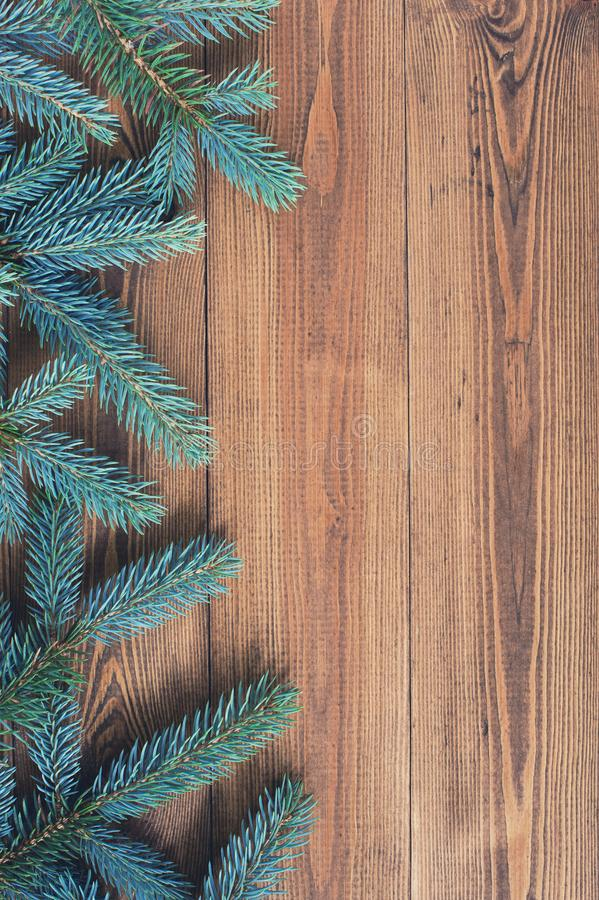 Natural brown wooden background with spruce brunches stock photos