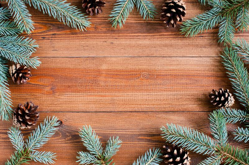 Natural brown wooden background with spruce brunches royalty free stock photo