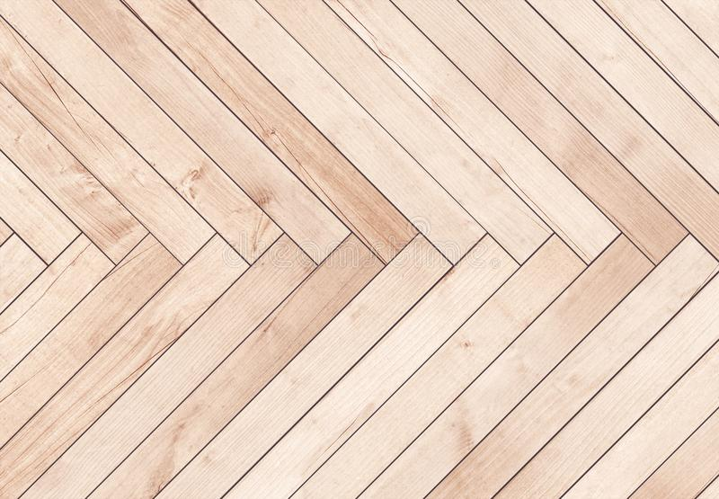 Natural brown wooden parquet herringbone. Wood texture. Natural brown wooden parquet herringbone. Wood texture stock photography