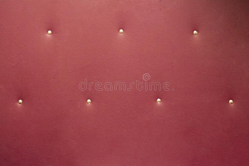 Natural burgundy leather background with buttons texture vintage royalty free stock photography