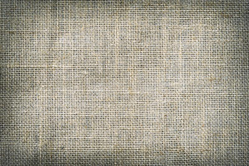 Natural canvas, sackcloth. Closeup of jute texture pattern with vignette, for vintage background stock images