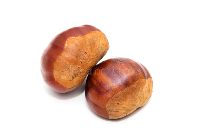 Natural chestnuts isolated. In white royalty free stock photography