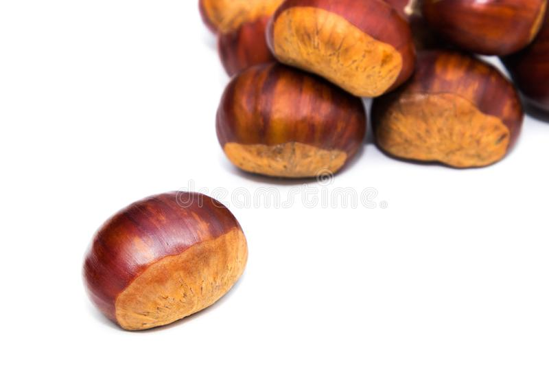 Natural chestnuts isolated. In white stock images