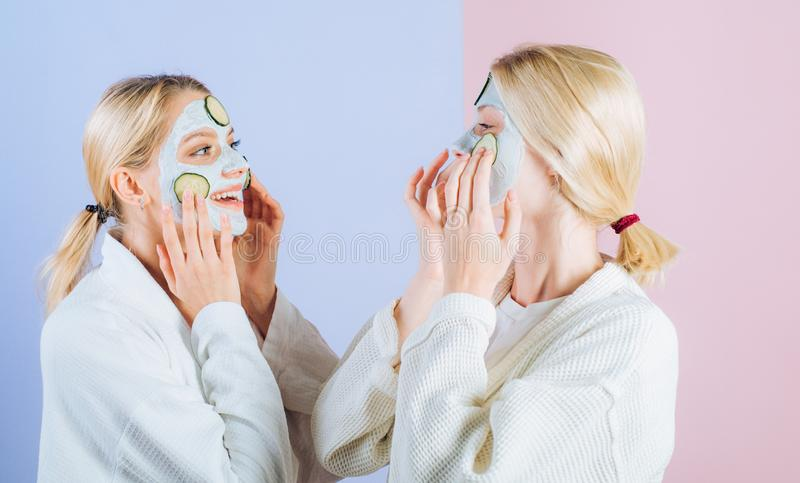 Natural clay facial mask. Girls friends, sisters or mom and daughter chilling making clay facial mask. Anti age mask royalty free stock photography