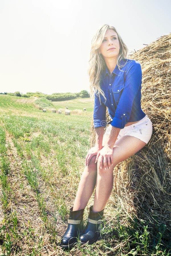 Natural clean and beautiful blonde girl woman. Haystack royalty free stock photo