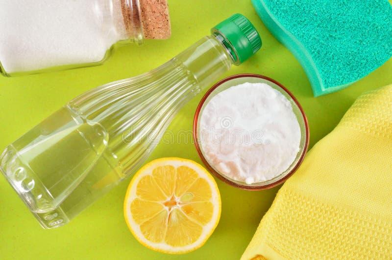 Natural cleaners. Vinegar, baking soda, salt and lemon. royalty free stock photography
