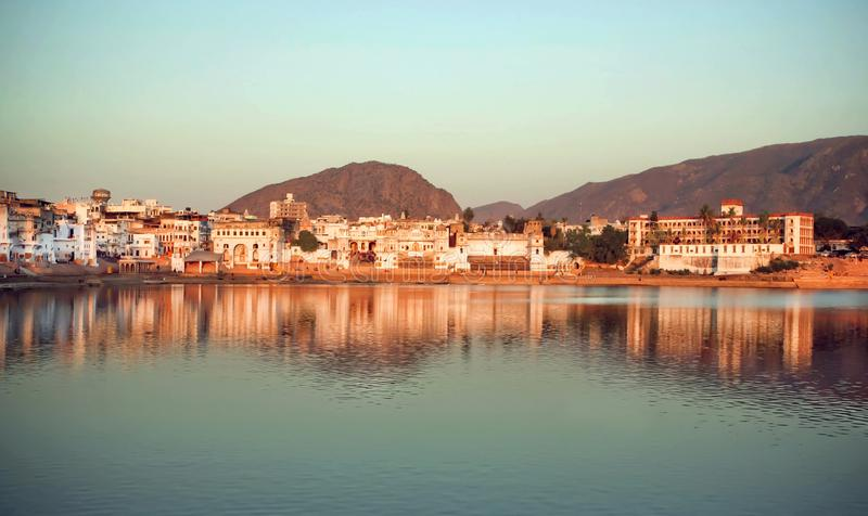 Natural color blue over indian Pushkar, holy lake, hills. Cityscape at evenng time with beautiful scene in India stock images