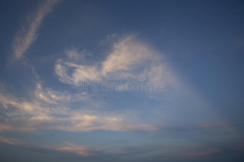 Natural colors Evening sky Shine new day  for Heaven,The light from heaven from the sky is a mystery,In twilight golden atmosphere. Modern sheet structure royalty free stock images