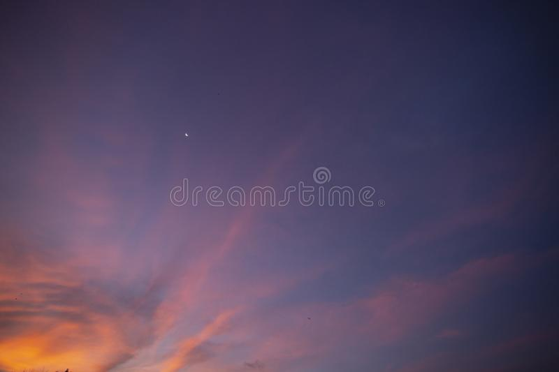 Natural colors Evening sky Shine new day  for Heaven,The light from heaven from the sky is a mystery,In twilight golden atmosphere. Modern sheet structure royalty free stock image