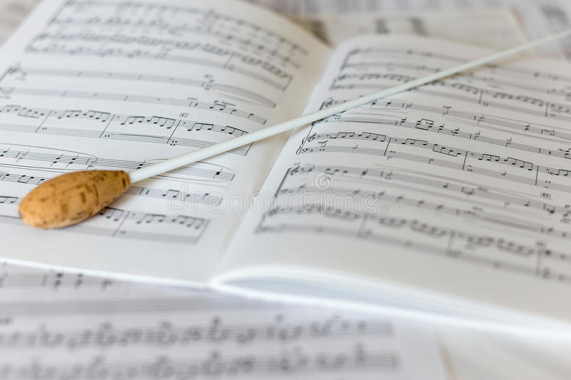 A natural conductors baton on orchestral score royalty free stock image