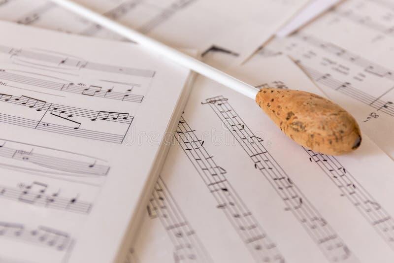 A natural conductors baton on sheet music stock image