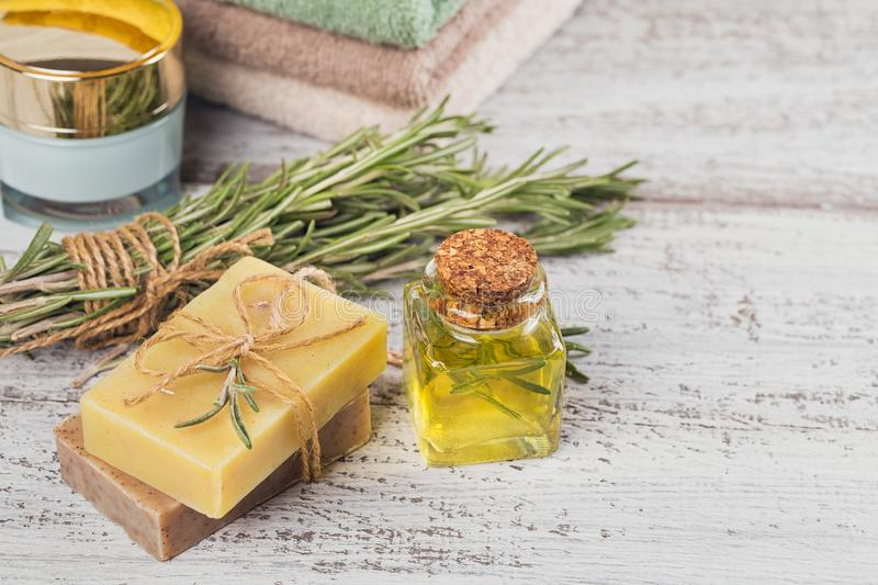 Natural cosmetic oil and natural handmade soap with rosemary on royalty free stock photos