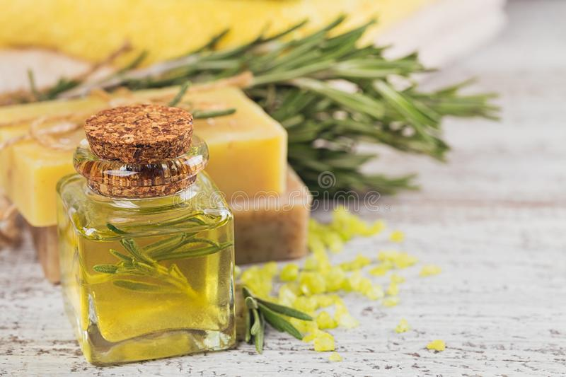 Natural cosmetic oil and natural handmade soap with rosemary on royalty free stock photography