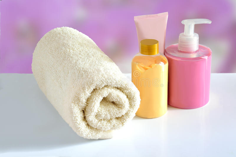 Natural Cosmetic products for skin care and terry cotton towel. Natural hypoallergenic herbal Cosmetic products for skin care: plastic dispenser with liquid soap stock image