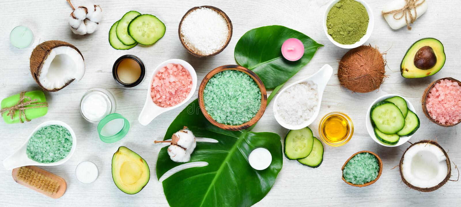 Natural Cosmetics: Avocado, coconut, sea salt and face cream. The concept of cosmetics and spa. Top view. Free copy space royalty free stock photo