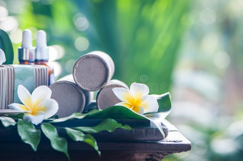 Natural cosmetics on a beautiful tropical background. Mineral, tropical cosmetics. Avocado, scarlet, lotus. Healthy lifestyle royalty free stock photos