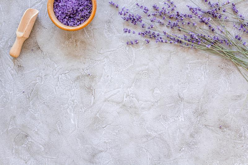 Natural cosmetics with lavender and herbs for homemade spa on stone background top view mock up stock photo