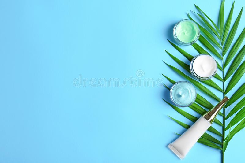 Natural cosmetics and leaf. On blue background stock images