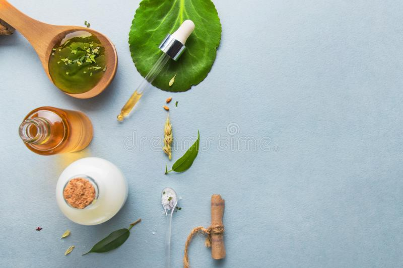 Natural cosmetics, oils for skin care on a light background. Homeopathic oils, whey, milk, soap. Beauty blogger concept. Natural cosmetics and oils for skin stock images