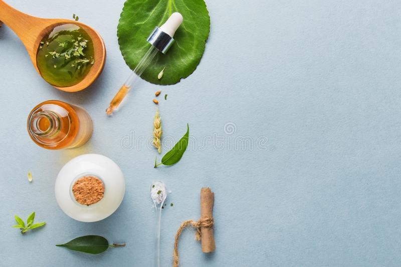 Natural cosmetics, oils for skin care on a light background. Homeopathic oils, whey, milk, soap. Beauty blogger concept. Natural cosmetics and oils for skin royalty free stock image